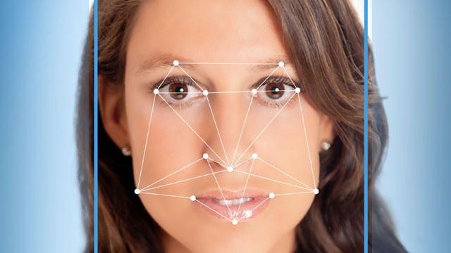 beautiful female face with futuristic face tracking grid